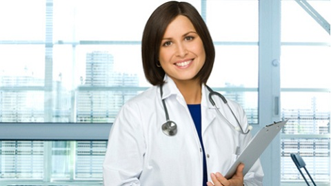 Woman Doctor On A Pale Background.